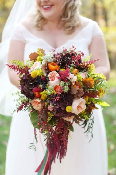 Image of bride holding flowers from Julie James Floral Design
