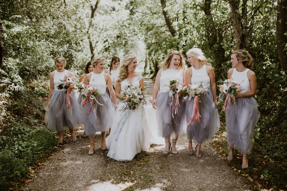 Image of bridesmaids carrying bouquets from Julie James Floral Design